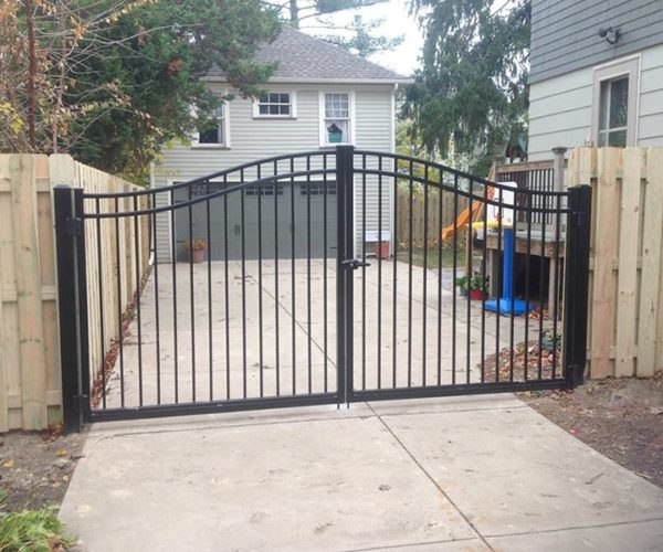 Residential-aluminum-swing-gate-wood-fence